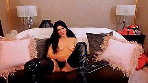 Latex boots and a dripping cock